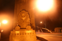 lion statue guarding lion gate bridge