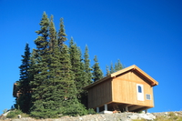 wooden cabin on the peak