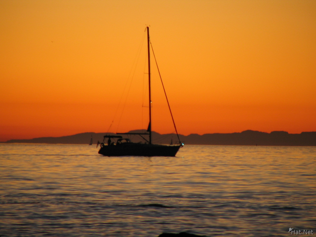 sail boat of flaming sky